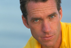 Portrait of a man with blue eyes wearing a yellow shirt