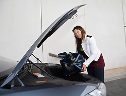 LIVERPOOL, ENGLAND - Thursday, June 19, 2014: Wimbledon Champion Marion Bartoli puts her tennis racquets in the 'frunk' of a Tesla Model S during Day 1 of the Liverpool Hope University International Tennis Tournament. (Pic by David Rawcliffe/Propaganda)