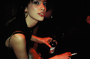 Attractive woman smoking and drinking, Cobden Club, U.K, XMAS, 2000.