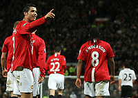 Photo: Paul Thomas/Sportsbeat Images.<br /> Manchester United v Fulham. The FA Barclays Premiership. 03/12/2007.<br /> <br /> Cristiano Ronaldo (Pointing) and Man Utd celebrate his 2nd goal.