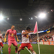 Tim Cahill, New York Red Bulls, celebrates with his trademark corner flag punch after his 97th minute  header leveled the scores at 2-2 during the New York Red Bulls V New England Revolution, Major League Soccer regular season match at Red Bull Arena, Harrison, New Jersey. USA. 5th October 2013. Photo Tim Clayton