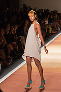 A beige-gray halter-top dress with deep armholes and dip hemline.