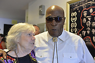 Bellmore, New York, USA. 16th July 2015. Actress MARILYN CHRIS and actor JOHN AMOS talk at the 18th Annual LIIFE Awards Ceremony, at Bellmore Movies. Chris was long-time character Wanda Web Wolek on the TV soap opera One Life to Live, which Amos played Detective Johnson in the late 1980s. Chris presented the Documentary Award at the Long Island International Film Expo. Amos was an LIFTF Lifetime Creative Achievement Honoree for his work in films such as ROOTS, and DIE HARD 2, and COMING TO AMERICA.
