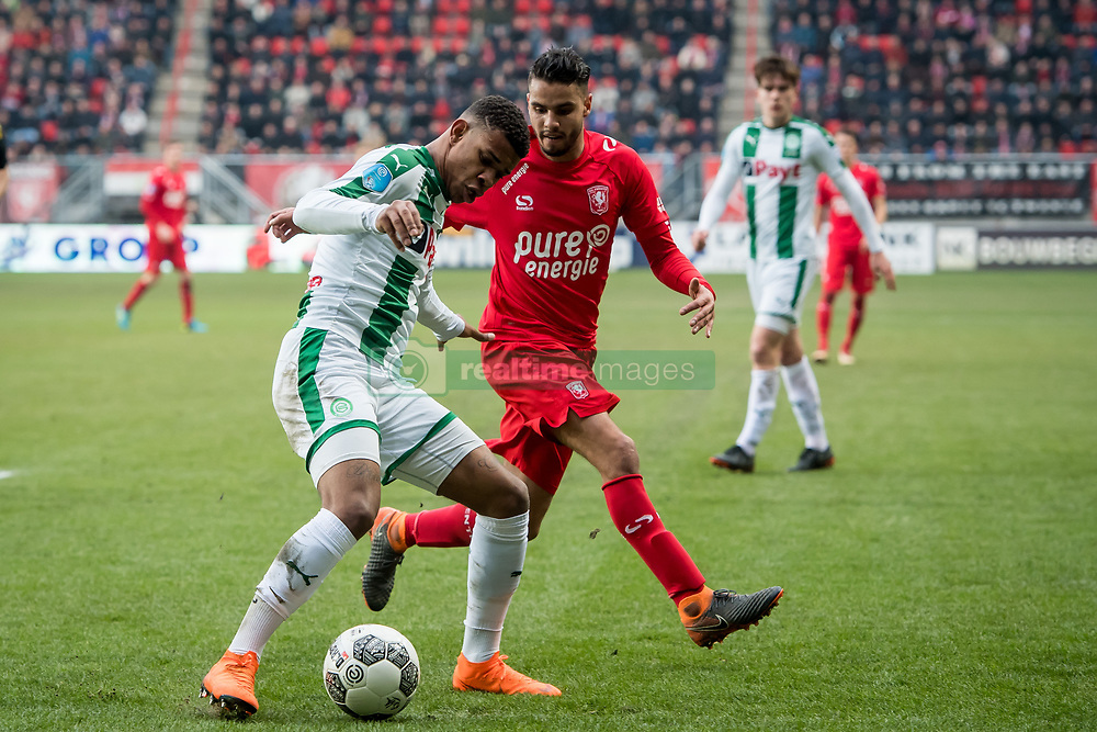 (L-R) Juninho Bacuna of FC Groningen, Adam Maher of FC Twente during the Dutch Eredivisie match between FC Twente Enschede and FC Groningen at the Grolsch Veste on March 04, 2018 in Enschede, The Netherlands