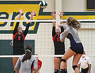 West Delaware's Addison Brooks (3) and Paige Soppe (12) try to block a shot by Cedar Rapids Xaver's Kasey VandenBosch (6) in the Class 4A regional final match at Beckman High School in Dyersville on Tuesday, November 5, 2013. West Delaware defeated Xavier 3-1.