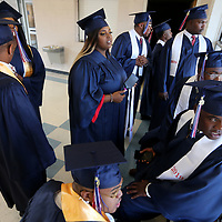 Baldwyn High School seniors look out the window as they wait to walk to the gym for their graduation ceremony Friday night.
