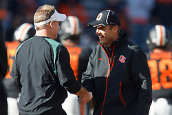 December 4, 2010; Corvallis, OR, USA;  Oregon Ducks head coach Chip Kelly (left) shakes hands with Oregon State Beavers head coach MIke Riley (right) before the game at Reser Stadium.