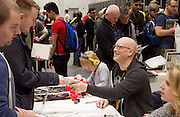 London Super Comic Convention <br /> at ExCel London, Great Britain <br /> 20th February 2016 <br /> <br /> Canadian artist David Finch signs fans books and art work <br /> inc Cyberforce, Ascension and Aphrodite IX<br /> <br /> <br /> Photograph by Elliott Franks <br /> Image licensed to Elliott Franks Photography Services
