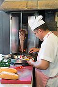 Chef at Ciya Sofrasi Turkish restaurant serving lamb doner kebab in Kadikoy district Asian side Istanbul, East Turkey