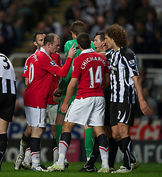 NEWCASTLE, ENGLAND - Tuesday, April 19, 2011: Manchester United's Wayne Rooney points his finger in the face of referee Lee Probert during the Premiership match against Newcastle United at St James' Park. (Photo by David Rawcliffe/Propaganda)