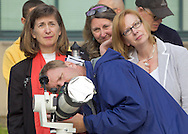 New Paltz, New York - People gather on the State University of New Paltz campus to watch the Transit of Venus through a filtered telescope on June 5, 2012. Venus crossed in front of the sun and was visible as a small black disk. The next Venus transit will not occur until 2117.