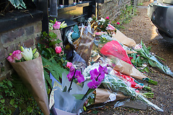 Highgate, London, December 26th 2016. Fans gather outside the London home of pop icon George Michael who died on Christmas day. PICTURED: Floral tributes begin to build up outside the gate of George Michael's house.