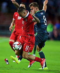 BELGRADE, SERBIA - Sunday, June 11, 2017: Wales' Emyr Huws and Serbia's Aleksandar Kolarov during the 2018 FIFA World Cup Qualifying Group D match between Wales and Serbia at the Red Star Stadium. (Pic by David Rawcliffe/Propaganda)