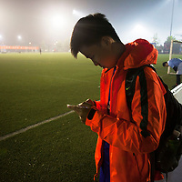 BEIJING, OCT.18, 2014 : Song Yonglin, 14, arrives at the soccer field, but can't find his team. He spends every weekend taking extra school lessons in order to improve his scores which cost his parents about 4-5000 Yuan/month. He would like to switch to the International school in Beijing  and study economics later on in the US.