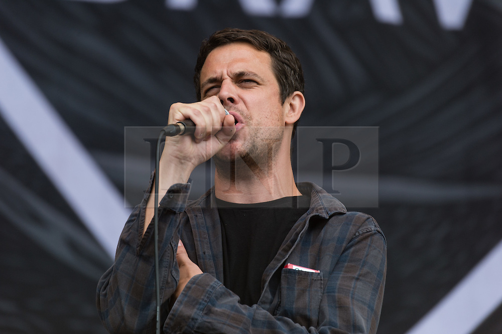 © Licensed to London News Pictures. 30/08/2015. Reading, UK. Lonely the Brave performing at Reading Festival 2015, Day 3 Sunday.  In this picture - David Jakes.  Photo credit: Richard Isaac/LNP
