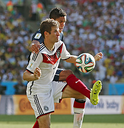 04.07.2014, Maracana, Rio de Janeiro, BRA, FIFA WM, Frankreich vs Deutschland, Viertelfinale, im Bild Thomas Mueller from Germany fights for the ball against Raphael Varane from France // during quarterfinals between France and Germany of the FIFA Worldcup Brazil 2014 at the Maracana in Rio de Janeiro, Brazil on 2014/07/04. EXPA Pictures © 2014, PhotoCredit: EXPA/ Eibner-Pressefoto/ Cezaro<br /> <br /> *****ATTENTION - OUT of GER*****