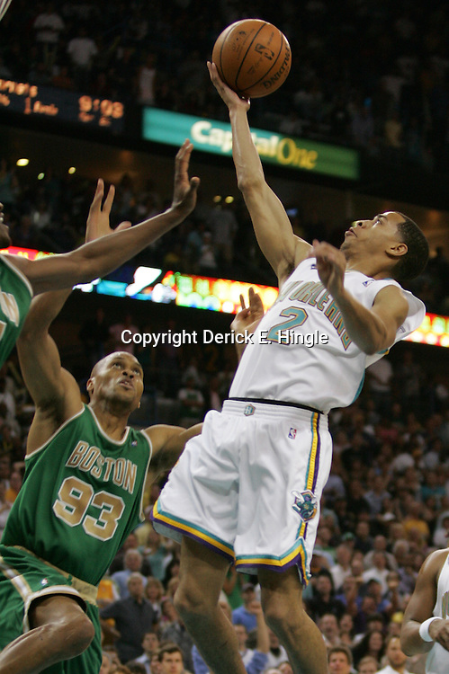 Jennero Pargo # 2 of the New Orleans Hornets shoot as Boston Celtics center P.J. Brown #93 defends in the third quarter of their NBA game on March 22, 2008 at the New Orleans Arena in New Orleans, Louisiana. The New Orleans Hornets defeated the Boston Celtics 113-106.