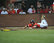 Mississippi's Austin Anderson (8) scores on a Will Allen hit vs. Louisiana-Lafayette in an NCAA Super Regional game in Lafayette, La. on Sunday, June 8, 2014. Mississippi won 5-2.