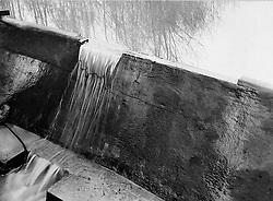 © Licensed to London News Pictures. 21/03/2006 Watford, UK. A 50th scale model of The Möhne Dam at the Building Research Establishment, Watford, Herts being breach tested in 1941. The model was the first piece in the jigsaw which led to the successful Dambusters raid on the night of May 16th, 1943. Records in BRE's archive show that in late 1940, William Glanville of the Road Research Laboratory brought Barnes Wallis to a secret meeting with Dr Norman Davey at the site near Watford. At the meeting, Wallis' plans to attack the Mohne and Eder dams were outlined and it was decided that the most effective way to determine the weight of explosive and optimum location to detonate it was to construct and test a scale model. Norman Davey built the model at BRE in 1941 and work began testing by staff of the Road Research Laboratory, under Dr A Collins. The model dam's discovery was published as the final shots for the film The Dambusters were being recorded, and the very first tests at BRE were not reported in the film classic..Photo credit : BRE Archive/LNP