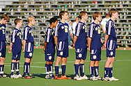 20 Nov. 2009 -- FENTON, Mo. -- Members of the St. Pius X soccer team pause for the National Anthem prior to the start of their MSHSAA Class 1 state semifinal against Whitfield at the A-B Soccer Center in Fenton, Mo. Friday Nov. 20, 2009. Whitfield won the match 2-1.  Photo © copyright 2009 by Sid Hastings.