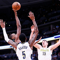 01 April 2018: Milwaukee Bucks forward Khris Middleton (22) goes for the baby hook over Denver Nuggets forward Will Barton (5) and Denver Nuggets center Nikola Jokic (15) during the Denver Nuggets 128-125 victory over the Milwaukee Bucks, at the Pepsi Center, Denver, Colorado, USA.