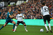 Duane Holmes holds off a challenge from Herbie Kane during the EFL Sky Bet Championship match between Derby County and Hull City at the Pride Park, Derby, England on 18 January 2020.