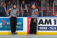 KELOWNA, CANADA - OCTOBER 5:  Referees Brett Roeland and Chris Crich stand at the timekkeer box and review a goal by the Victoria Royals against the Kelowna Rockets on October 5, 2018 at Prospera Place in Kelowna, British Columbia, Canada.  (Photo by Marissa Baecker/Shoot the Breeze)  *** Local Caption ***