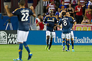 FRISCO, TX - AUGUST 11:  Landon Donovan #10 of the Los Angeles Galaxy celebrates after scoring a goal with his teammates against FC Dallas on August 11, 2013 at FC Dallas Stadium in Frisco, Texas.  (Photo by Cooper Neill/Getty Images) *** Local Caption *** Landon Donovan
