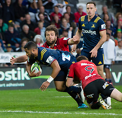 Highlanders' Lima Sopoaga, left, dives in to score a try against the Crusaders in the Super Rugby match, Forsyth Barr Stadium, Dunedin, New Zealand, Saturday, March 17, 2018. Credit:SNPA / Adam Binns ** NO ARCHIVING**