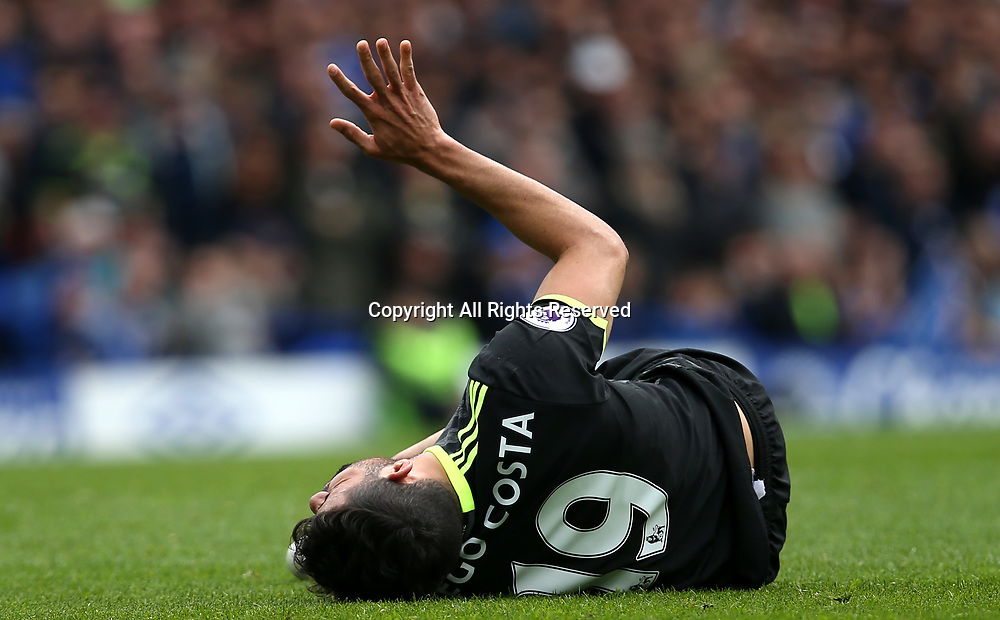 April 30th 2017, Goodison Park, Liverpool, England; EPL Premier league football, Everton versus Chelsea; Diego Costa of Chelsea lies injured after a heavy tackle from Ross Barkley of Everton