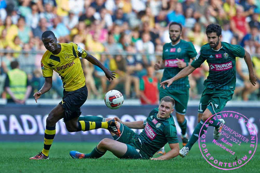 (L) Adrian Ramos of Dorussia Dortmund fights for the ball with (R) Tomasz Holota of Slask Wroclaw during international friendly soccer match between WKS Slask Wroclaw and BVB Borussia Dortmund on Municipal Stadium in Wroclaw, Poland.<br /> <br /> Poland, Wroclaw, August 6, 2014<br /> <br /> Picture also available in RAW (NEF) or TIFF format on special request.<br /> <br /> For editorial use only. Any commercial or promotional use requires permission.<br /> <br /> Mandatory credit:<br /> Photo by &copy; Adam Nurkiewicz / Mediasport