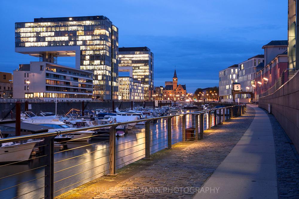 the Crane Houses in the Rheinau harbour, in the background the old harbour masters office, Cologne, Germany.<br /> <br /> die Kranhaeuser im Rheinauhafen, im Hintergrund das alte Hafenamt, Koeln, Deutschland.