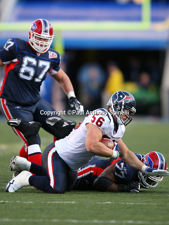 Houston Texans rookie linebacker Brian Cushing (56) intercepts a fourth quarter pass during the NFL football game against the Buffalo Bills, November 1, 2009 in Orchard Park, New York. The Texans won the game 31-10. (©Paul Anthony Spinelli)