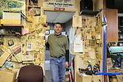 HVAC contractor standing inside his papered walls