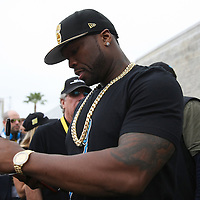 "Rap artist ""50Cent"" signs autographs for his fans during the 56th Annual NASCAR Daytona 500 practice session at Daytona International Speedway on Saturday, February 22, 2014 in Daytona Beach, Florida.  (AP Photo/Alex Menendez)"