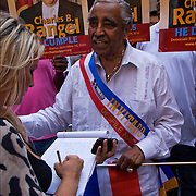 Rep.Charles Rangel, the Harlem leader, at the Dominican Day Parade giving interview, the day after he signed a plea deal with the House ethics committee. Rangel is up for re-election in November which is why his presents at the Dominican Day Parade is important.