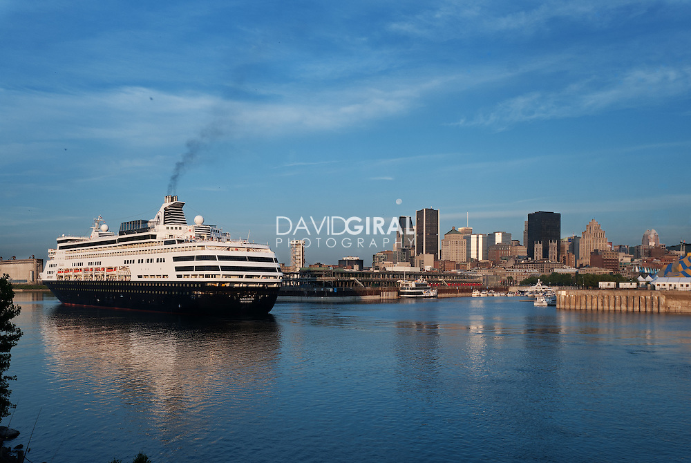 MS  Maasdam cruise ship arriving in Montreal's Old port and view of Montreal Skyline
