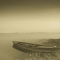 ALONE FISHING BOAT, PARKED LAKESIDE, THE TONED PERFECTION.