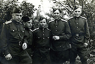 WWII era Soviet Russian soldiers pose for a group photo.