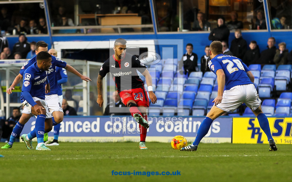 Daniel Williams (centre) of Reading passes the ball during the Sky Bet Championship match at St Andrews, Birmingham<br /> Picture by Tom Smith/Focus Images Ltd 07545141164<br /> 13/12/2014