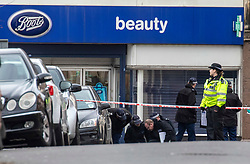 © Licensed to London News Pictures. 03/02/2020. London, UK. Forensic officers on Streatham High Road outside Boots Chemists where a knife-wielding terror suspect in a suicide vest was shot dead yesterday after stabbing two people. Photo credit: Alex Lentati/LNP
