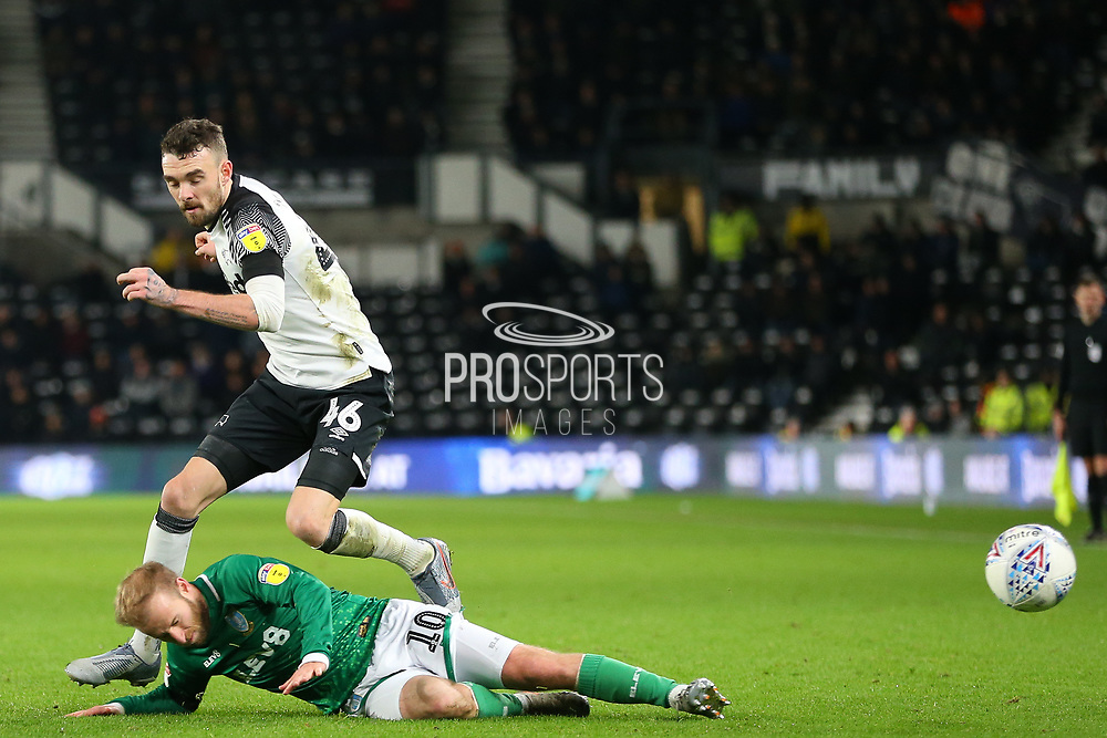 Sheffield Wednesday midfielder Barry Bannan (10) slides inland takes the ball off Derby County defender Scott Malone (46) during the EFL Sky Bet Championship match between Derby County and Sheffield Wednesday at the Pride Park, Derby, England on 11 December 2019.