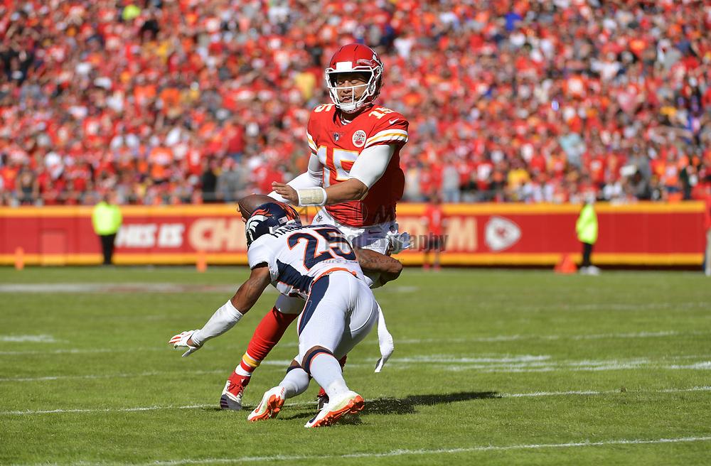 Oct 28, 2018; Kansas City, MO, USA; Kansas City Chiefs quarterback Patrick Mahomes (15) is tackled by Denver Broncos cornerback Chris Harris (25) during the first half at Arrowhead Stadium. Mandatory Credit: Denny Medley-USA TODAY Sports