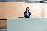 Receptionist talking on telephone in office
