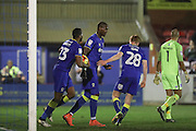 AFC Wimbledon striker Tyrone Barnett (23) scores a goal 1-2 and celebrates with AFC Wimbledon striker Tom Elliott (9) crosses the ball during the EFL Trophy match between AFC Wimbledon and U23 Brighton and Hove Albion at the Cherry Red Records Stadium, Kingston, England on 6 December 2016. Photo by Stuart Butcher.