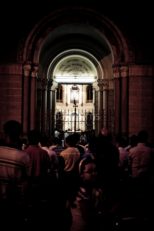 Congregants gather outside cathedral for evening services, Saigon Vietnam