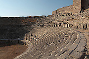 The Hellenistic theatre, 4th century BC, later enlarged by the Romans in the 2nd century AD, Miletus, Aydin, Turkey. The new building under Emperor Trajan seated 25,000 and a third floor was added to the stage building, which was decorated with columns and hunting scenes with Eros. In the centre of the first two rows, four columns designated a special box for the emperors. The theatre was situated on the edge of the harbour. Miletus was an Ancient Greek city on the Western coast of Anatolia. Although settlement began here millennia ago, its heyday was in the Hellenistic and Roman periods. The city was finally abandoned in the Ottoman era when the harbours silted up. Picture by Manuel Cohen