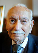 "© Licensed to London News Pictures. 02/02/2012, Kingston Upon Thames,UK. 104 year-old becomes Britain's oldest new citizen. 104 year-old TAUFEEK KHANJAR became a British Citizen at a ceremony held by Surrey County Council today (01 February 2012). Mr Khanjar is originally from Iraq and worked as a jewellery maker in Baghdad. He came to the UK six years ago to live with his daughter Nada Dabis, 59, in South Cheam, Surrey, where he enjoys walking, feeding the birds, playing cards and listening to music. He is a widower with four sons and two daughters. Durning the ceremony Mr Khanjar took an oath to the Queen, pledging that he will be a faithful citizen and obey the laws of the country. He explained the secret to a long and healthy life was to ""never get stressed and be relaxed"".  Photo credit : Stephen Simpson/LNP"