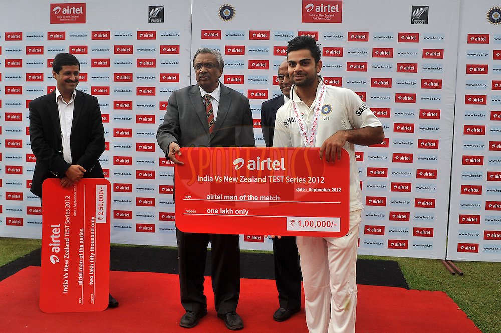 Virat Kohli of India receives the man of the match award during the presentation during day four of the second test match between India and New Zealand held at the M. Chinnaswamy Stadium, Bengaluru on the 3rd September 2012..Photo by Pal Pillai/BCCI/SPORTZPICS
