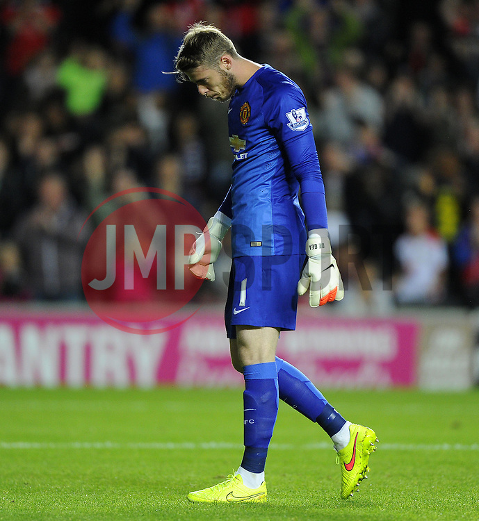 Manchester United's David De Gea cuts a dejected figure - Photo mandatory by-line: Joe Meredith/JMP - Mobile: 07966 386802 26/08/2014 - SPORT - FOOTBALL - Milton Keynes - Stadium MK - Milton Keynes Dons v Manchester United - Capital One Cup